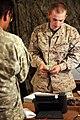 U.S. Marine Corps Lance Cpl. Austin Jones, a disbursing clerk, counts money before handing it to a U.S. Soldier at Forward Operating Base (FOB) Edinburgh, Afghanistan, June 2, 2011 110602-M-UV027-186.jpg