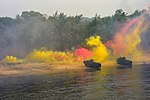 U.S. Marines assigned to the 31st Marine Expeditionary Unit, embarked aboard the amphibious dock landing ship USS Tortuga (LSD 46), use Marine Corps assault amphibious vehicles, smoke flares and explosives 130621-N-PD773-572.jpg