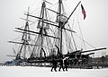 U.S. Sailors assigned to the USS Constitution walk near the ship's berth in Charlestown Navy Yard, Mass., Jan. 2, 2014, during the year's first winter storm 140102-N-SU274-003.jpg