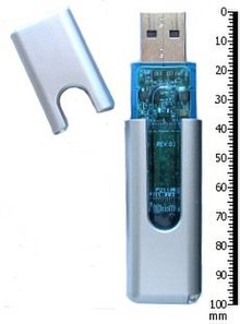 Thumb drive and its cap, next to a 100-mm ruler