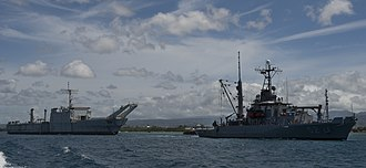 USS Tuscaloosa (LST-1187) - Image: USNS Salvor (T ARS 52) tows USS Tuscaloosa (LST 1187) from Pearl Harbor in July 2014