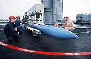 USS Arkansas (CGN-41) loading a GMTR in aft Mk 26 launcher