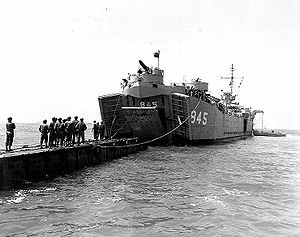 "LST-845 ""married"" to a pontoon causeway during landing operations in Korean/Japanese waters, 26 March 1951"