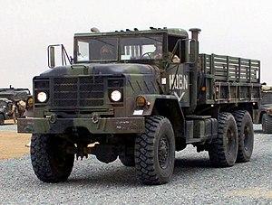 US Marine Corps 030224-M-XT622-034 USMC M923 (6X6) 5-ton cargo truck heads a convoy departing Camp Matilda, Kuwait crop