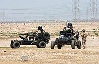 US Navy 020413-N-5362A-013 U.S. mararmeo SEAL (SEa, Aero, tero) funkciigas Desert Patrol Vehicles (DPV) preparante por suprenalvenmision.jpg