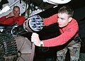 US Navy 030210-N-5796A-025 Aviation Ordnanceman perform maintenance on the M61A1 Vulcan 20mm cannon.jpg