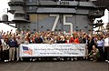 US Navy 030423-N-9964S-001 Sailors and Marines gather on the flight deck in front of the ship's island, aboard USS Harry S. Truman (CVN 75) for a group photo with a congressional delegation, led by Speaker of the House J.jpg