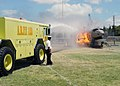 US Navy 030718-N-5024R-001 A Mobile Air Rescue Fire Fighting unit from Wheeler Air Force Base, Hawaii holds a demonstration following a ceremony, in which Pearl Harbor acquired three new fire trucks from the Pierce Manufacturin.jpg