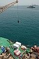 US Navy 040516-N-9885M-011 The tugboat Al-Towfan cranes equipment over to the Al Basrah Oil Terminal (ABOT).jpg