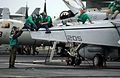 US Navy 040527-N-6213R-160 Aviation Mechanics service an F-A-18E Super Hornet.jpg