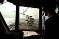 US Navy 041023-N-1348L-021 Lt.j.g. Mathias Roth, observes an SH-60B Seahawk helicopter.jpg