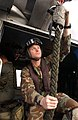 US Navy 041207-N-0413R-011 Intelligence Specialist 1st Class Chad Munroe of Eugene, Ore., assigned to Explosive Ordnance Mobile Unit Eleven (EODMU-11), Detachment Five, ensures the fast rope is secured to the hoist mechanism.jpg