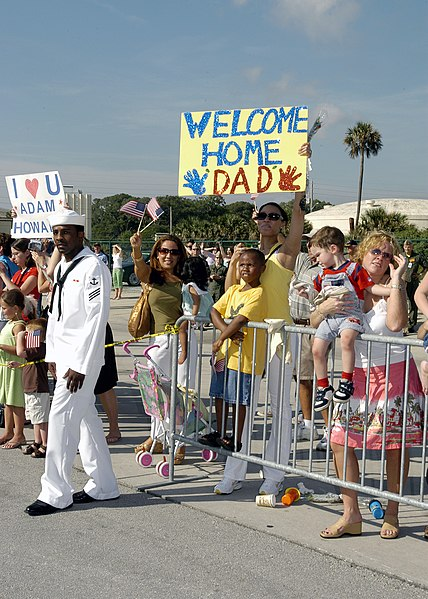 File:US Navy 050606-N-1550W-030 Friends and Family wait for Sailors from the guided missile frigate USS Taylor (FFG 50) to disembark the ship after returning home to Naval Station Mayport.jpg