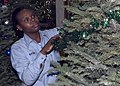 US Navy 051130-N-5686B-003 U.S. Navy Personnel Specialist 3rd Class Stephanie Burton, assigned to the guided missile destroyer USS Fitzgerald (DDG 62), decorates the command's Christmas tree.jpg