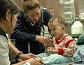 US Navy 060527-N-3153C-042 Navy Lt.Cmdr. Elizabeth Ferrara, pediatrician, checks a young boy's vital signs onboard the hospital ship USNS Mercy (T-AH 19).jpg
