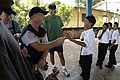 US Navy 060822-N-8298P-007 Chief petty officer selectees assigned to the guided-missile destroyer USS Carney (DDG 64) participate in a community relations (COMREL) project for the Escuela la Provareda Elementary School located.jpg
