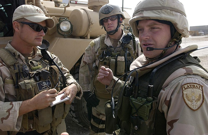 File:US Navy 061030-F-7426P-038 Officer in Charge of U.S. Navy Explosive Ordnance Disposal Mobile Unit Three (EODMU-3) Lt. A. J. Pajack, conduct a predeparture convoy brief with a Latvian army convoy commander.jpg
