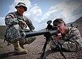 US Navy 061223-N-1328C-509 Army Sgt. Mijung Kim, left, from Harmon, Guam, observes Marine Corps Sgt. John Rheuby, from Hueytown, Ala., as Rheuby fires an M-24 rifle during a familiarization shoot.jpg
