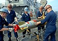 US Navy 070208-N-4973A-055 Sailors upload anti-submarine warfare torpedoes aboard guided missile destroyer USS O'Kane (DDG 77). O'Kane is currently a part of USS John C. Stennis Strike Group (JCSSG).jpg