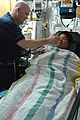US Navy 070622-N-9421C-046 Lt. Dwight Christensen takes a patient's temperature after surgery aboard amphibious assault ship USS Peleliu (LHA 5).jpg