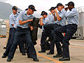US Navy 070716-N-0807W-026 Sailors from mine warfare ship USS Guardian (MCM 5) learn defensive scenario drills for a required security reaction force basic course.jpg