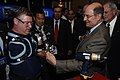 US Navy 070807-N-3642E-403 Secretary of the Navy (SECNAV) the Honorable Dr. Donald C. Winter, gives his official SECNAV coin to Chuck Hilderth during the Defense Advanced Research Projects Agency (DARPA) Tech conference.jpg