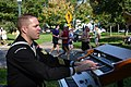 """US Navy 071007-N-7163S-004 Musician 1st Class Steve Kendell assigned to Navy Band Great Lakes """"Horizon"""" entertains passing runners at the 15 mile marker of the Twin Cities Marathon.jpg"""