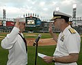 US Navy 080604-N-8848T-071 Rear Adm. Jon W. Bayless, right, the commander of Navy Region Midwest, reenlists Navy Counselor 1st Class Sean Nagle at U.S. Cellular Field.jpg