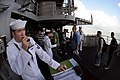 US Navy 080619-N-5961C-003 Interior Communications Specialist 2nd Class Paul Lewis stands Petty Officer of the Watch aboard the Nimitz-class aircraft carrier USS Ronald Reagan (CVN 76) while moored in Hong Kong.jpg