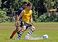 US Navy 090221-N-3830J-146 Information Systems Technician 2nd Class Kevin M. Abney, assigned to the amphibious command ship USS Blue Ridge (LCC 19), advances past a defender during a soccer match.jpg