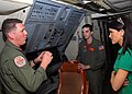 US Navy 090314-N-3013W-045 Naval Air Crewman 1st Class Adam Herzog explains the acoustic equipment of a P-3C Orion aircraft assigned to Patrol Squadron (VP) 16 to staff members of the U.S. House of Representatives House Armed S.jpg