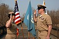 US Navy 090401-N-9573A-004 Capt. Deidre McLay, Chief of Staff for Commander, U.S. Naval Forces Korea, re-enlists Chief Personnel Specialist Brian Robinson, from Villa Grove, Ill., on the Bridge of No Return at the Demilitarized.jpg