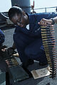 US Navy 090925-N-3038W-126 Aviation Ordnanceman Airman Recruit Janelle Ray prepares .50 cal. ammunition belts before a live-fire exercise aboard the aircraft carrier USS Nimitz (CVN 68).jpg