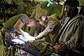 US Navy 090926-M-2581P-000 .S. Navy corpsmen provide medical care for an Afghan boy at Forward Operating Base Geronimo in Helmand Province, Afghanistan.jpg
