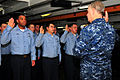 US Navy 100106-N-7939W-198(1) Chief of Naval Operations (CNO) Adm. Gary Roughead recites the oath of reenlistment with Sailors during a reenlistment ceremony.jpg
