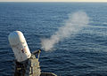 US Navy 100223-N-5969B-106 The amphibious assault ship USS Peleliu (LHA 5) fires its Close-In Weapons System (CIWS) during a weapons exercise off the coast of Southern California.jpg