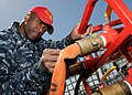 US Navy 100511-N-2259P-019 Damage Controlman 1st Class Brian Clegg inspects a fire hose aboard USS John Paul Jones (DDG 53).jpg