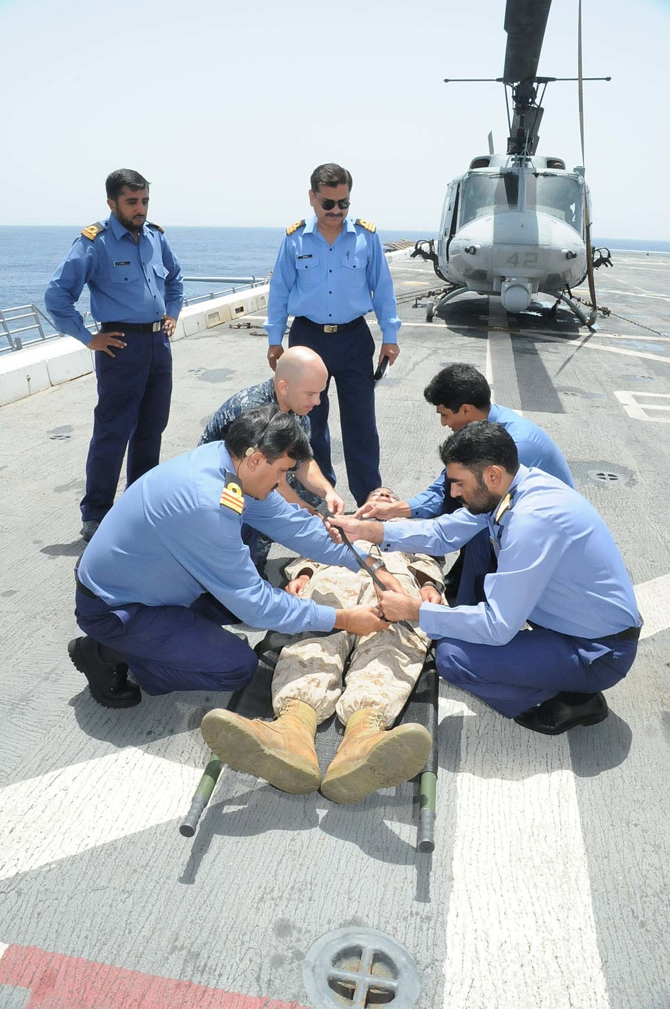 US Navy 100605-N-3973P-124 Pakistani navy Surgeons and Hospital Corpsman 2nd Class Nicholas Marcotte use a raven litter stretcher to transport Hospital Corpsman 2nd Class William West during a medical training exercise