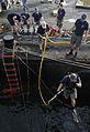US Navy 100616-N-4776G-570 Navy Diver 1st Class Lars Nilsson completes a front step water entry before diving under USS The Sullivans (DDG 68).jpg