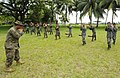 US Navy 100708-N-9643W-101 Sgt. Juan Martinez demonstrates a front jab to a group of sailors from the Guatemalan navy.jpg