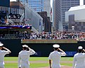 US Navy 100721-N-0869H-089 Sailors salute the national ensign during the National Anthem at Target Field before a Minnesota Twins game.jpg
