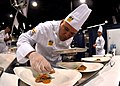 US Navy 100805-N-3069F-002 Chief Culinary Specialist Brandon Parry, assigned to Commander, Naval Air Forces in San Diego, plates his main entree during the American Culinary Federation's Chef of the Year competition.jpg