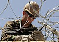 US Navy 100812-N-6357K-001 Builder 2nd Class Joshua McCart, assigned to Naval Mobile Construction Battalion (NMCB) 7, installs protective razor wire at the weapons armory at Camp Mitchell on Naval Station Rota, Spain.jpg