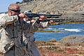 US Navy 100820-N-9123L-162 Navy Reserve Information Systems Technician 2nd Class Michael Sprinkle and Electrician's Mate 2nd Class Derek Smith fire the M500 shotgun during a live-fire exercise.jpg