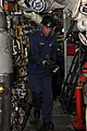 US Navy 101107-N-7293M-146 Machinist's Mate 3rd Class Shawn Stevens removes a burner barrel from the No.1 boiler aboard USS Ponce (LPD 15) during a.jpg