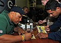 US Navy 110214-N-2908M-043 Super Bowl XLV champions, the Green Bay Packers, sign autographs for Sailors and Marines aboard the amphibious assault s.jpg