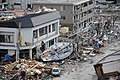 US Navy 110315-N-2653B-118 A fishing boat is among debris in Ofunato, Japan, following a 9.0 magnitude earthquake and subsequent tsunami.jpg