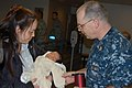 US Navy 110324-N-4104L-003 Senior Chief Personnel Specialist Matthew Winstel greets a five-day-old baby and his mother at Travis Air Force Base dur.jpg