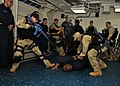 US Navy 110620-N-NL541-107 Members of the visit, board, search and seizure (VBSS) team aboard the guided-missile frigate USS Thach (FFG 43) demonst.jpg