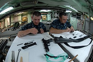 USS Helena (SSN-725) - Image: US Navy 110621 N NK458 140 Sailors conduct maintenance on small arms in the torpedo room aboard the Los Angeles class attack submarine USS Helena (